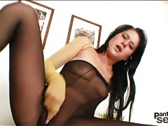 Dark haired cutie plays in sexy pantyhose tubes