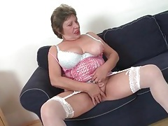 Granny in stockings shares her big tits tubes