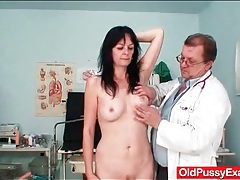 Leggy mature pussy examined with a speculum tubes
