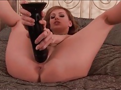 Sexy solo girl fucks her cunt with a huge toy tubes