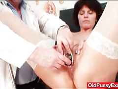 Mature keeps her stockings on for medical exam tubes