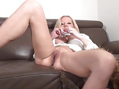 Blonde milf with a sexy set of fake tits masturbates tubes