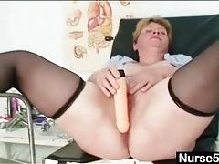 Bbw in black stockings spreads her legs in stirrups tubes
