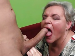 Granny gets on her knees and sucks dick tubes