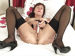 Granny in sexy lipstick and stockings masturbates tubes