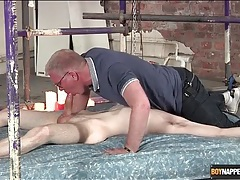 Gay daddy blows the cute twink in bondage tubes