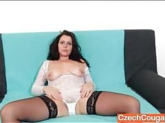 Curvy brunette in white lingerie toys her box tubes