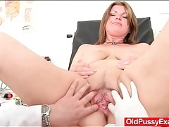 Curvaceous mature examined by her doctor tubes