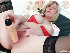 Mature chick in nurse uniform has perky tits tubes