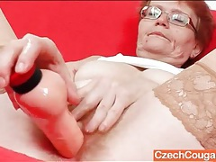 Redhead granny with hairy pussy fucks a toy tubes