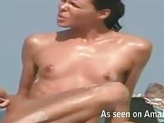 Lean body babe with a tan at the beach tubes