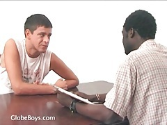 Young white guy sucks on black cock tubes