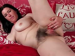 Cute brunette milf models her hairy pussy tubes