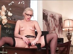 Hot blonde in glasses sits on a black dildo tubes