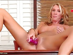 Blue eyed mommy with long legs fucks a toy tubes