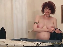 Mature talks to camera and strips naked tubes