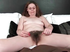 Milf runs her fingers through her hairy pussy tubes