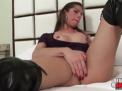 Sexy solo shemale tease in leather boots tubes