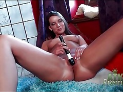 Beauty in red lingerie strips and toys her pussy tubes