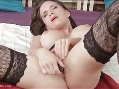 Babe with big fake tits masturbates in stockings tubes