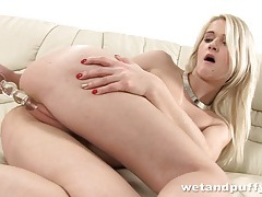 Fit blonde slowly toys her puffy cunt lips tubes