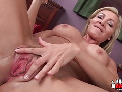 Milf pussy worn out by a big black dildo tubes