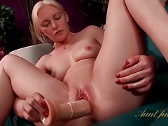 Pierced clit blonde fucks a big dildo tubes