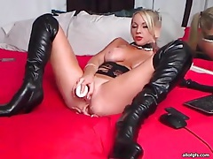Devastatingly sexy webcam girl in leather boots tubes
