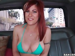Bikini babe shows her hot tits in the car tubes