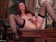 Redheaded milf temptress in sexy stockings tubes