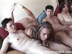 Slut blows a bunch of guys in a group video tubes