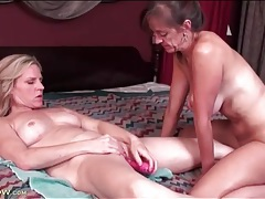 Mommies have naughty fun with a pink dildo tubes