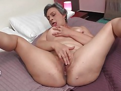 Grey hair granny masturbates alone in bed tubes