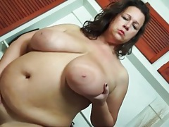 Fat girl in stockings has big saggy tits tubes