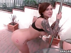 Tattooed hottie teases her amazing ass outdoors tubes