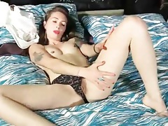 Tattooed chick in pretty pink lipstick plays solo tubes