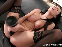 Stockings and heels babe fucks a big toy tubes