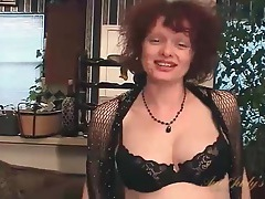 Cute mature redhead fondles her big tits tubes