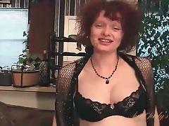 Cute mature redhead fondles her big tits tubes