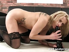 She lubes up with her piss and ass fucks a toy tubes