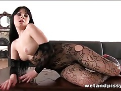 Dirty girl gets hot and bothered pissing on her body tubes