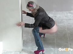 Girl sneaks into a construction site and pisses tubes