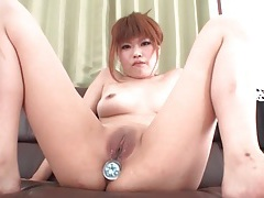 Jeweled butt plug fills her japanese asshole tubes