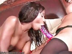 Black lesbian sensually sucks on strapon tubes