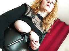 Slutty leather and fishnets on a mature redhead tubes