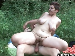 Sex in a grassy field with a naughty old lady tubes