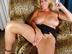 Mama with a lovely manicure rubs her cunt tubes
