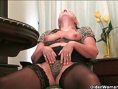 Granny with a thick belly masturbates in stockings tubes
