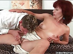 Sexy mature in a turtleneck sweater loves young cock tubes