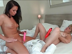 Gorgeous young brunette plays with an old lady tubes